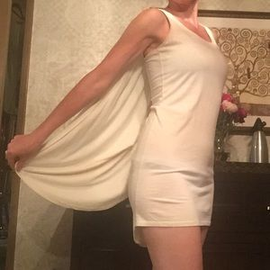 Mini dress with cape.